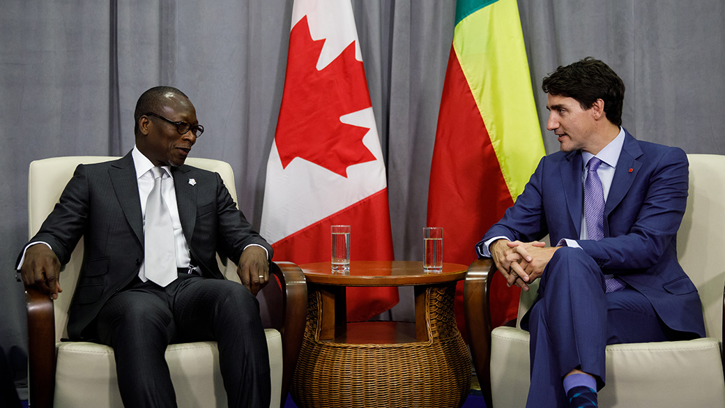 PM Trudeau sits and talks with President Patrice Talon