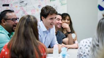 PM Trudeau laughs during the roundtable