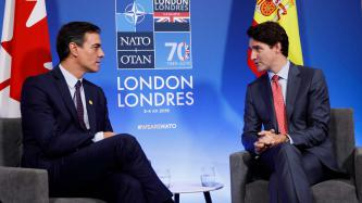 PM Justin Trudeau sits with the PM of Spain, Pedro Sánchez