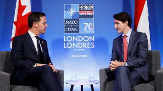 PM Justin Trudeau sits with the PM of the Netherlands, Mark Rutte