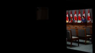 A view of PM Trudeau from a door window
