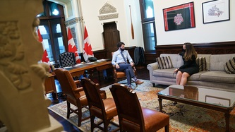 Prime Minister Trudeau and Deputy Prime Minister Freeland sit in a greeting area of an office