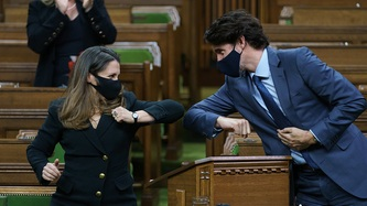 Deputy Prime Minister Chrystia Freeland and Prime Minister Justin Trudeau elbow bump