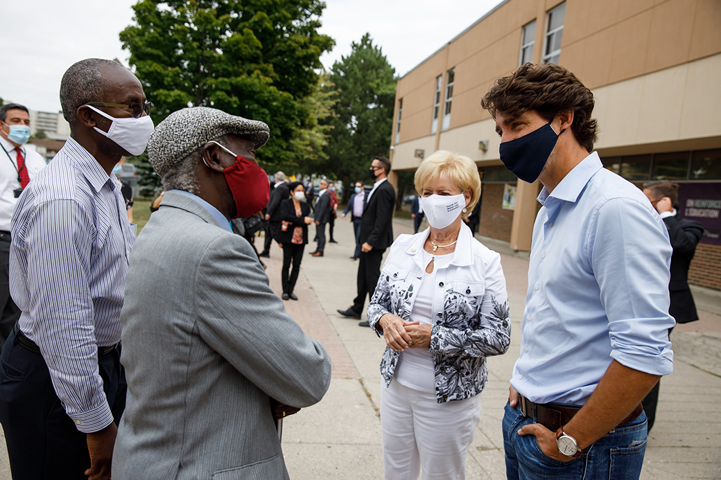 PM Justin Trudeau and MP Judy Sgro speak with educators in Toronto